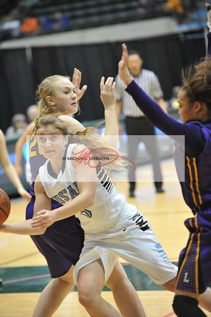 Chugiak's Nicole PInckney finds a hole in the defense of Lathrop's Olivia Kraska, left and Makenzie Warner.  Photo by Michael Dinneen for the Star.