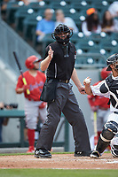 Home plate umpire Skyler Shown makes a strike call during the International League game between the Louisville Bats and the Charlotte Hornets at BB&T BallPark on June 22, 2019 in Charlotte, North Carolina. The Hornets defeated the Bats 7-6. (Brian Westerholt/Four Seam Images)