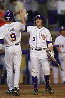 LSU Tigers first base Mason Katz #8 greets teammate Mark Laird #9 after he scores against the Auburn Tigers in the NCAA baseball game on March 22nd, 2013 at Alex Box Stadium in Baton Rouge, Louisiana. LSU defeated Auburn 9-4. (Andrew Woolley/Four Seam Images).