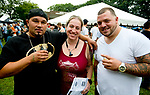 WATERBURY, CT-090818JS10--Joseph Sepulveda, Justine Sepulveda an Miguel Rosario, all from Waterbury, at the 13th annual Brass City Brew &amp; 'Que brew festival and barbecue Saturday at Library Park in Waterbury. <br />  Jim Shannon Republican American
