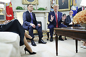 (L-R) Polish First Lady Agata Kornhauser-Duda, Polish President Andrzej Duda and US President Donald J. Trump during a meeting in the Oval Office of the White House in Washington, DC, USA, 12 June 2019. Later in the day President Trump and President Duda will participate in a signing ceremony to increase military to military cooperation including the purchase of F-35 fighter jets and an increased US troop presence in Poland. <br /> Credit: Shawn Thew / Pool via CNP