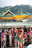 FRENCH POLYNESIA, Moorea. Passengers boarding a ferry to Papeete, Tahiti.