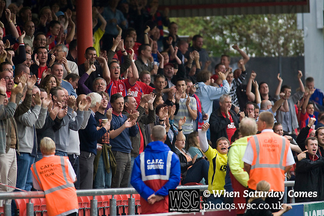 Fans of Aldershot Town in the Blue Bell BMW Stand, celebrating their team's second goal during the League 2 fixture between Crewe Alexandra and Aldershot Town at the Alexandra Stadium. The visitors won by 2 goals to 1.
