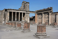 Basilica, Pompeii, 2nd century BC. Located on the South West side of the Forum it is one of the oldest remaining examples of a Roman Basilica. The Podium, where the Judge probably sat, is fronted by 6 Ionic columns. More columns supported the roof of the vast chamber
