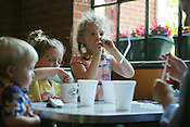 May 23, 2008. Durham, NC..Wilder Semans, 6, plays with her straw while at dinner with her siblings (left to right) Tucker, 1, and Annabel, 4, and mother Connie at Elmo's Diner on Friday, May 23rd, 2008 in Durham.