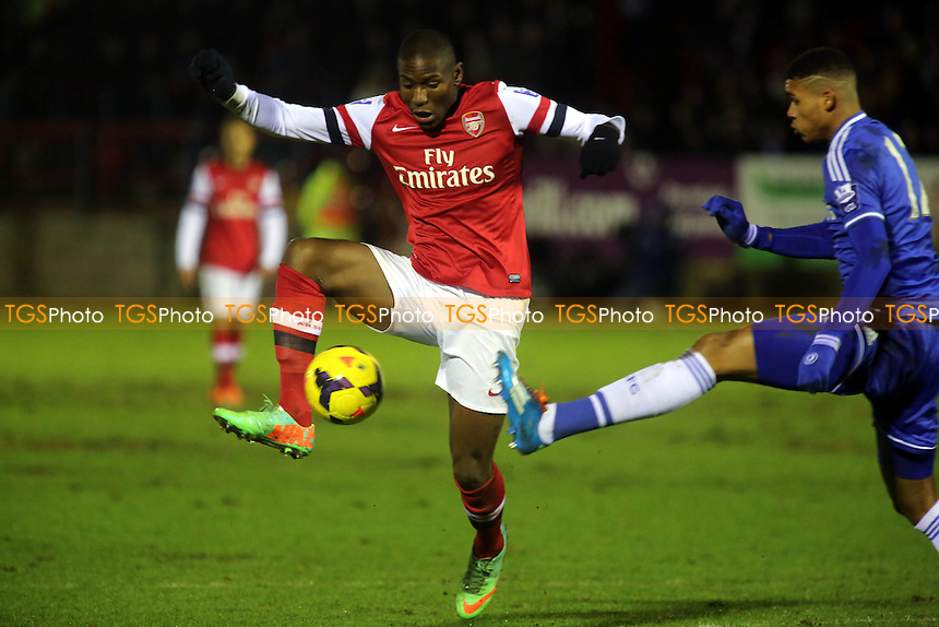 Benik Afobe of Arsenal controls the ball under pressure from Chelsea's Ruben Loftus Cheek - Chelsea Under-21 vs Arsenal Under-21 - Barclays Under-21 Premier League Cup Football at Aldershot FC - 27/01/14 - MANDATORY CREDIT: Paul Dennis/TGSPHOTO - Self billing applies where appropriate - 0845 094 6026 - contact@tgsphoto.co.uk - NO UNPAID USE