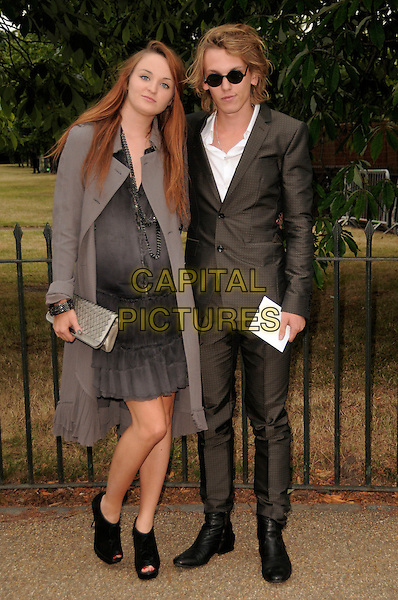 GUEST & JAMIE CAMPBELL BOWER.The Summer Party at The Serpentine Gallery, London, England. .July 9th, 2009 .full length black dress grey gray suit sunglasses shades coat sunglasses shades clutch bag .CAP/CAS.©Bob Cass/Capital Pictures.