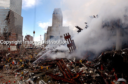New York (NY) USA - Sept 13, 2001. Firemen and rescuers work in the rubble of twin World Trade Center after 911 terrorist attack in New York.