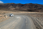 Car unsurfaced road, barren rocky mountains, Jandia peninsula, Fuerteventura, Canary Islands, Spain