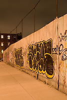 Graffiti Spray Painted on a Metal Fence in the Williamsburg section of Brooklyn, New York City, New York State, USA