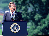United States President George H. W. Bush makes remarks prior to signing the Americans with Disabilities Act of 1990 into law during a ceremony on the South Lawn of the White House in Washington, D.C. on July 26, 1990. The act prohibited employer discrimination on the basis of disability. <br /> Credit: Ron Sachs / CNP