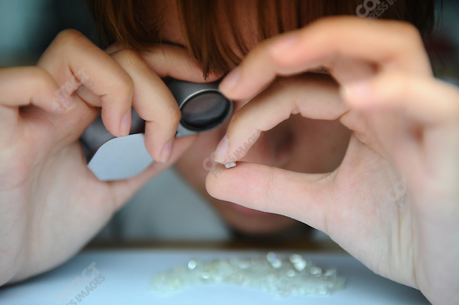 Sorters at the Alrosa headquarters in Moscow go through piles of small diamonds, often they will sort and examine between 500 and 1,000 carats worth of diamonds a day. Moscow, Russia, May 8, 2009.