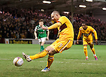 Michael Higdon scores from the penalty spot to equalise for Motherwell