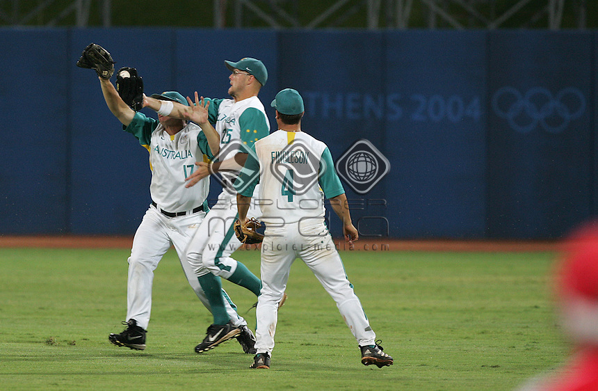 Australians Brett Roneberg and Thomaas Brice fight for the ball as Gavin Fingleson looks on. Cuba won to take the Gold Medal.<br /> Baseball - Men's Final<br /> Summer Olympics - Athens, Greece 2004<br /> Day 12, 25th August 2004.<br /> &copy; Sport the library/Sandra Teddy