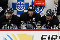 PITTSBURGH, PA - NOVEMBER 21:  Sidney Crosby #87 of the Pittsburgh Penguins shares a laugh with teammate Chris Kunitz #14 after his first goal of the season in the first period against Anders Nilsson #45 of the New York Islanders during the game on November 21, 2011 at CONSOL Energy Center in Pittsburgh, Pennsylvania. Crosby has not played a game since January 5th after sustaining a concussion.  (Photo by Jared Wickerham/Getty Images)