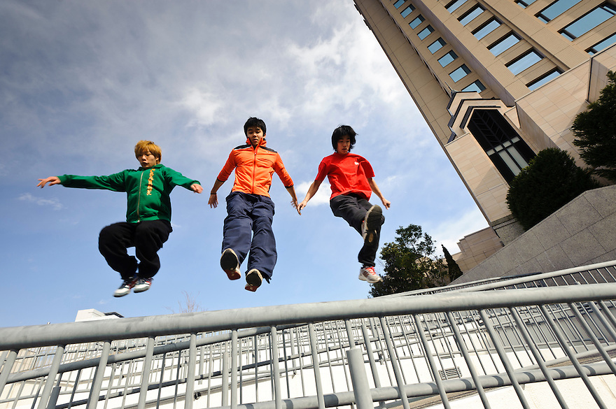 "(L to R) Traceurs (Parkour practitioners) ""Zen"", Jun ""Sullivan"" Sato, and ""Yutaro"". Practicing Parkour in Odaiba, Tokyo, Japan, January 27, 2012. Parkour is a modern method of physical training, also known as freerunning. It was founded in France in the 1990s. There is a small group of around 50 parkour practitioners in Tokyo."