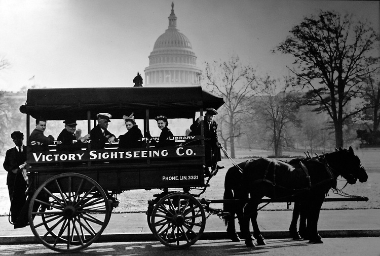 Faced with a shortage of gasoline in 1942, tourists had to resort to horse-drawn buses for their transportation around Washington D.C. Sightseeing buses would make frequent stops to the city's main attractions which included the Capitol.