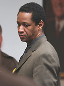 Sniper suspect John Allen Muhammad looks around the court after being found guilty on four charges in courtroom 10 at the Virginia Beach Circuit Court in Virginia Beach, Virginia on November 17, 2003.<br /> Credit: Dave Ellis - Pool via CNP