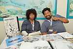 Garden City, New York, U.S. - June 14, 2014 - PARIS CULLINS, at right, illustrator of Blue Devil, New X-Men and more, is one of the professional comics illustrators at Eternal Con, the annual Pop Culture Expo, held at the Cradle of Aviation Museum on Long Island.