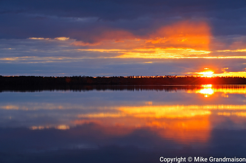 Sun breaking through clouds on White Lake<br /> Whiteshell Provincial Park<br /> Manitoba<br /> Canada