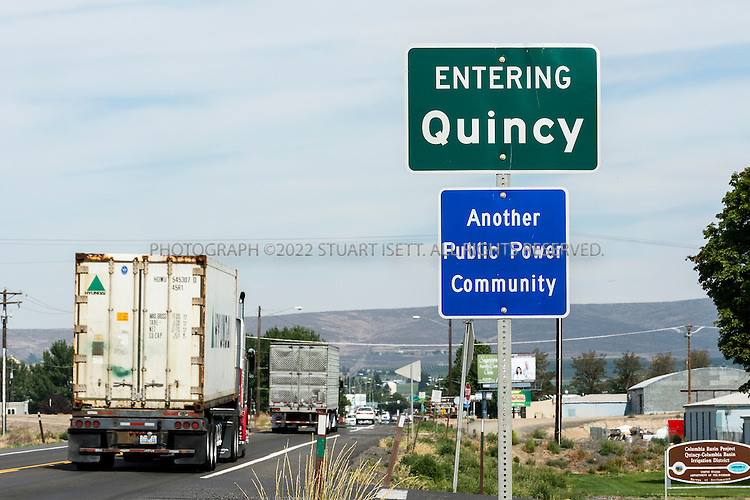 "8/20/2012--Quincy, WA...A road sign entering into Quincy announces that the town is ""Another Public Power Community"". ..Quincy has seen rapid growth of data centers, or server farms, spurred on by tax breaks and low cost electricity produced by the Grant Count PUD's nearby hydroelectric dams. Microsoft and five other companies, including Yahoo and Dell, have brought big, energy-hungry data centers to Quincy in recent years, converting former bean fields into vital hubs on the internet...©2012 Stuart Isett. All rights reserved."