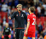 Jurgen Klopp manager of Liverpool greets Lucas Leiva of Liverpool during the Premier League match at Anfield Stadium, Liverpool. Picture date: September 10th, 2016. Pic Simon Bellis/Sportimage