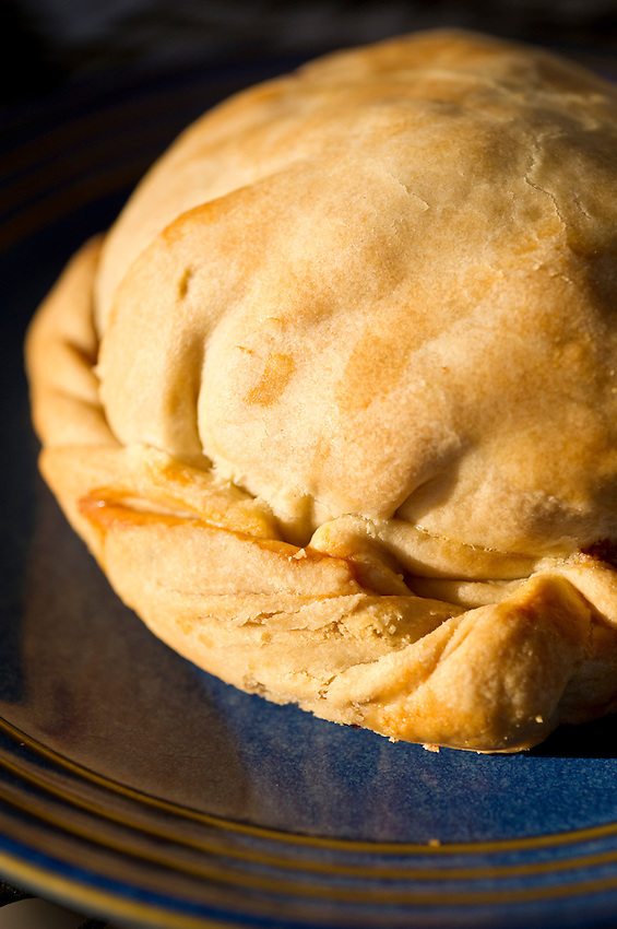 The Cornish pasty is a meat and vegetable pie cooked in pastry and typically found in mining regions like Michigan's Upper Peninsula.