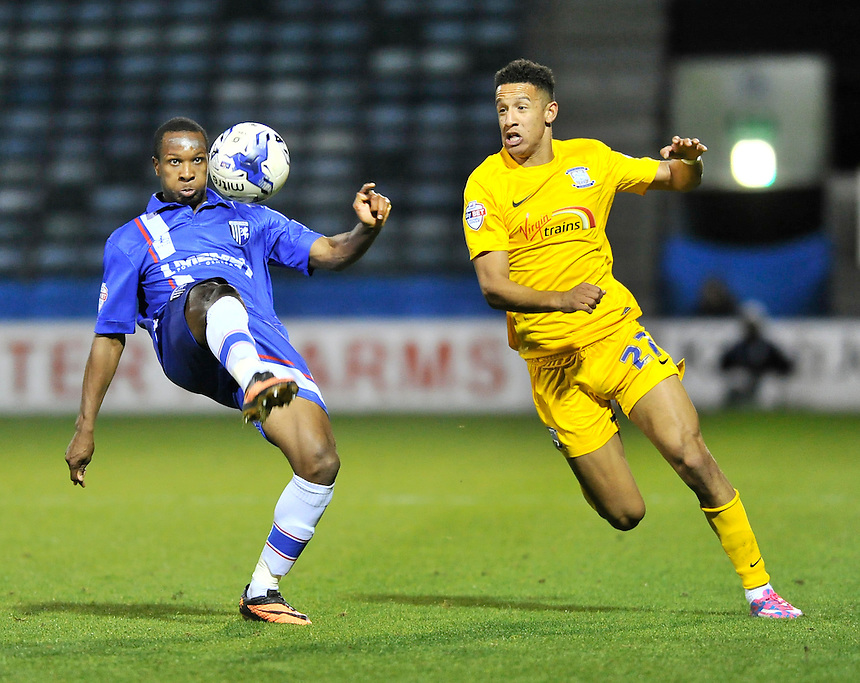 Gillingham's Gavin Hoyte holds off the challenge from Callum Robinson<br /> <br /> Photographer Ashley Western/CameraSport<br /> <br /> Football - The Football League Sky Bet League One - Gillingham v Preston North End - Tuesday 21st October 2014 - MEMS Priestfield Stadium - Gillingham<br /> <br /> &copy; CameraSport - 43 Linden Ave. Countesthorpe. Leicester. England. LE8 5PG - Tel: +44 (0) 116 277 4147 - admin@camerasport.com - www.camerasport.com