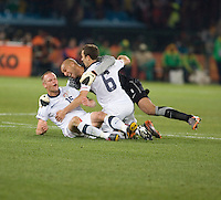 The USA's  (left to right) Jay DeMerit, Tim Howard, Steve Cherundolo celebrate defeated Algeria 1-0 to win Group C and advancing to the second round of the 2010 FIFA World Cup.  USA played Algeria in a 2010 FIFA World Cup match at Loftus Versfeld Stadium in Tshwane/Pretoria, South Africa on Wednesday, June 23, 2010.