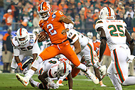 Charlotte, NC - December 2, 2017: Clemson Tigers quarterback Kelly Bryant (2) avoids a tackle during the ACC championship game between Miami and Clemson at Bank of America Stadium in Charlotte, NC.  (Photo by Elliott Brown/Media Images International)