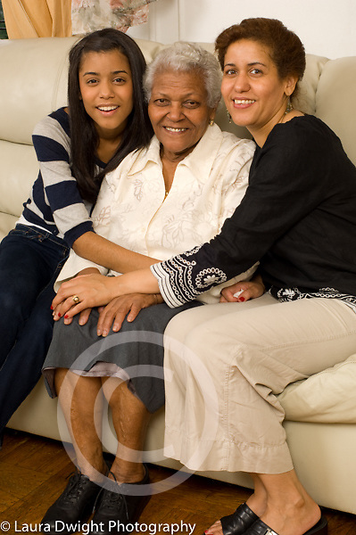 three female generations of one family maternal grandmother, mother in 40s, and daughter, age 20 Dominican-American