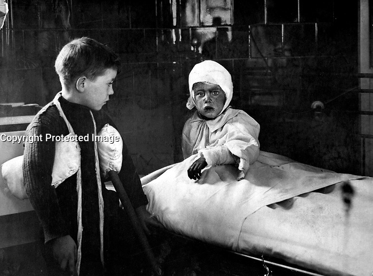 The Great Air Raid on London.  Some of the wounded school children in a hospital. Ca. 1915. British Official. (War Dept.) <br /> Exact Date Shot Unknown<br /> NARA FILE #:  165-WW-179A-14<br /> WAR &amp; CONFLICT BOOK #:  681