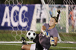 07 November 2008: Virginia Tech goalkeeper Kristin Carden makes the first of four saves in the penalty kick shootout. The University of Virginia and Virginia Tech played to a 1-1 tie after 2 overtimes at WakeMed Stadium at WakeMed Soccer Park in Cary, NC in a women's ACC tournament semifinal game.  Virginia Tech advanced to the final on penalty kicks, 2-1.