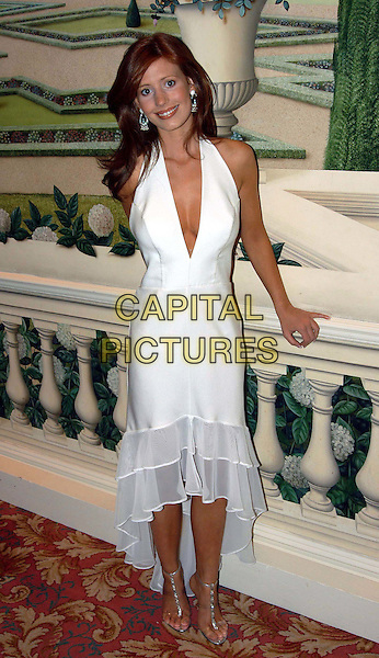 AMY NUTTALL.Royal Television Society awards .Grosvenor House Hotel.www.capitalpictures.com.sales@capitalpictures.com.©Capital Pictures.white halterneck dress, chiffon frill, t bar shoes, tbar shoes, tanned, plunging neckline