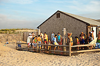Vacationers wash off sand in oudoor beach showers, Nauset Beach, Cape Cod, MA, USA