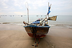 A fishing boat sits on the beach in Mui Ne, Vietnam. Nov. 20, 2011.