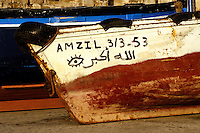 Essaouira, Morocco - Fisherman's Boat, with Evil Eye Talisman and Allahu Akbar (God is Great) Painted on the Side.