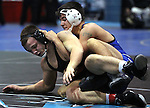 Carson's Brady Rivera competes against North Medfords's Kaden Johnson at the Sierra Nevada Classic wrestling tournament in Reno, Nev., on Friday, Dec. 28, 2012.  .Photo by Cathleen Allison