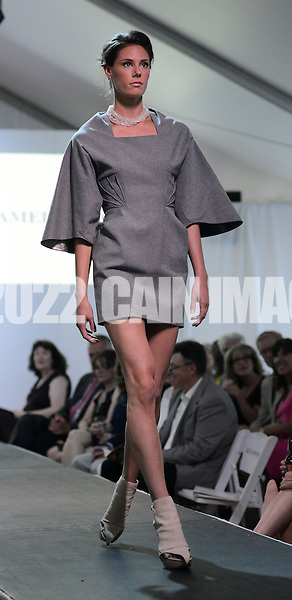 DOYLESTOWN, PA - JUNE 06: A model walks the runway during the Canines on the Catwalk fashion show June 6, 2014 at the Michener Museum in Doylestown, Pennsylvania. Canines on the Catwalk is a fashion show coupling professional models, high-end clothes and dogs. The program benefits animal rescue  (Photo by William Thomas Cain/Cain Images)