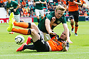 Hibs' Lewis Allan is challenged by Dundee Utd's Callum Morris.