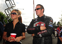 Aug. 7, 2011; Kent, WA, USA; NHRA funny car driver Jeff Diehl (right) with wife Leeza Diehl during the Northwest Nationals at Pacific Raceways. Mandatory Credit: Mark J. Rebilas-