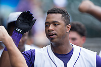 Eloy Jimenez (27) of the Winston-Salem Dash is congratulated by teammates after hitting a home run against the Salem Red Sox at BB&T Ballpark on July 23, 2017 in Winston-Salem, North Carolina.  The Dash defeated the Red Sox 11-10 in 11 innings.  (Brian Westerholt/Four Seam Images)