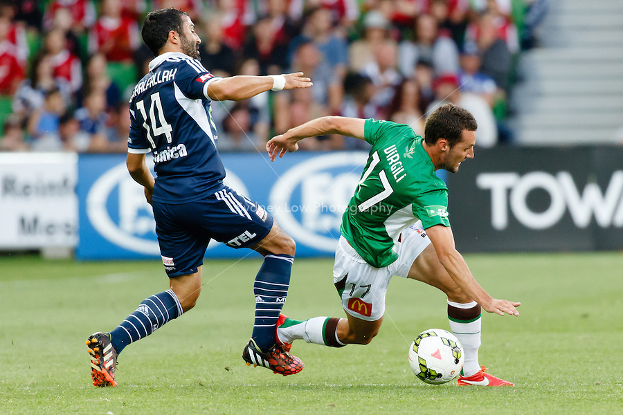 Fahid BEN KHALFALLAH of the Victory and James VIRGILI (17) of the Jets fight for the ball in round 12 A-League match between Melbourne Victory and Newcastle Jets at AAMI Park in Melbourne, Australia during the 2014/2015 Australian A-League season. Melbourne def Newcastle 1-0