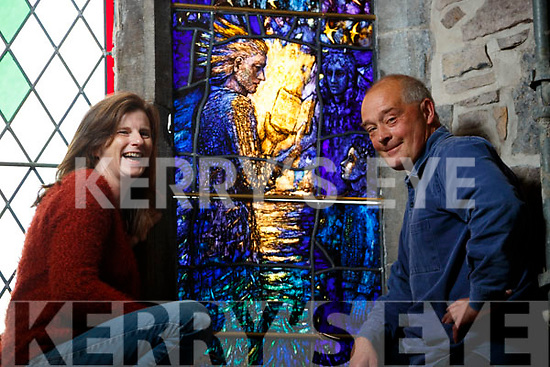 "Colette Langan and Tom Denny Installing the Stained Glass ""Reconciliation window"" in Saint Johns Church in Tralee."