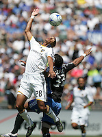 Galaxy's Sean Franklin (28) goes up for the header over San Jose's Scott Sealy (33). San Jose Earthquakes defeated LA Galaxy 3-2. August 3, 2008, McAfee Coliseum, Oakland, CA.