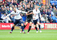 Bolton Wanderers' Adam Le Fondre, Leeds United's Kalvin Phillips and Bolton Wanderers' Josh Vela<br /> <br /> Photographer Rachel Holborn/CameraSport<br /> <br /> The EFL Sky Bet Championship - Bolton Wanderers v Leeds United - Sunday 6th August 2017 - Macron Stadium - Bolton<br /> <br /> World Copyright &copy; 2017 CameraSport. All rights reserved. 43 Linden Ave. Countesthorpe. Leicester. England. LE8 5PG - Tel: +44 (0) 116 277 4147 - admin@camerasport.com - www.camerasport.com