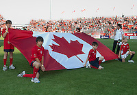 The flag of Canada during the opening ceremonies in an MLS game between the Seattle Sounders FC and the Toronto FC at BMO Field in Toronto on June 18, 2011..The Seattle Sounders FC won 1-0.