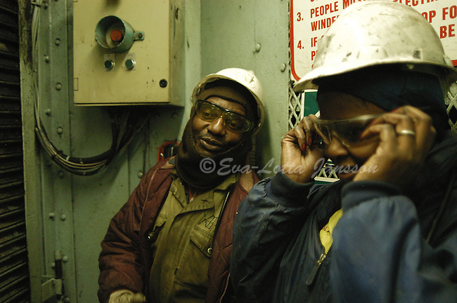 Nonhlanhla Mkhatshwa chats with cage driver Sipho Mkhabela as she puts on her safety goggles to head underground...