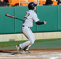 Right fielder Josh Hyman (22) of the Wofford Terriers hits a home run in the fourth inning of a game against the Clemson Tigers on Wednesday, March 6, 2013, at Doug Kingsmore Stadium in Clemson, South Carolina. Clemson won, 9-2. (Tom Priddy/Four Seam Images)