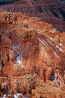 732700023 wide-angle view of red rock country at ten thousand feet with snow still clinging to the sandstone formations viewed from point supreme in cedar breaks national monument in utah